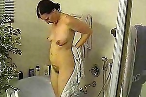 aged takes shower
