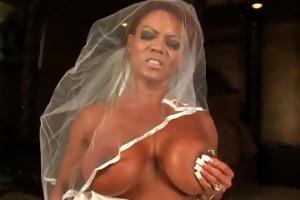 aziani metallic bodybuilder in wedding dress ride