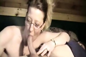 wild older wife engulfing the cock of her spouse