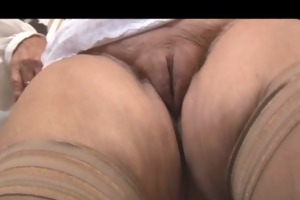 golden-haired granny in nylons posing and teasing
