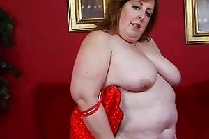 aged obese momma in corset sticks sextoy up her