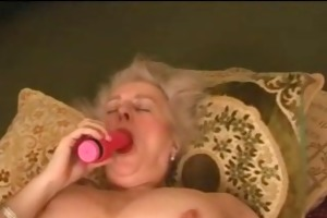 older granny breasty plays with her bushy cookie