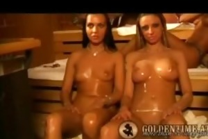 cuties making oil massage in the sauna