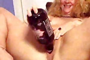 older puts a bottle in her fuck hole
