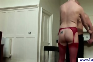 older mother i in nylons bent over kitchen table