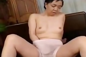 oriental granny playing with her fur pie