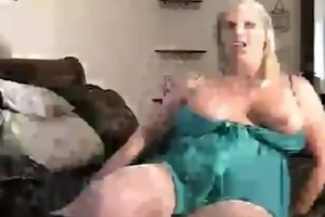 aged golden-haired woman show on web camera