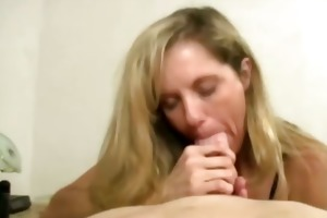 excited housewife engulfing off younger boy and