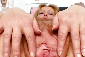 impure aged lady toys her hair