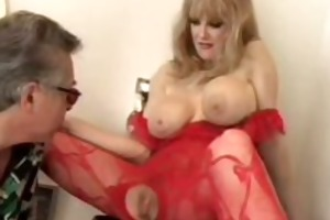 excited older in red bodystocking playing and