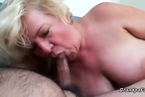 mature couple having sex on the bed