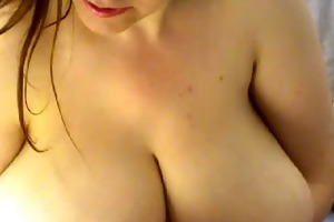 bulky brunette hair with massive love melons on