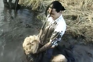 wicked older housewife overspread with mud