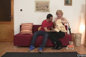golden-haired granny jumps on young knob