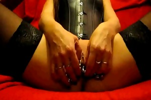 pierced lady shows her nice-looking cum-hole