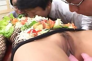 japanese av model turned into an edible table for