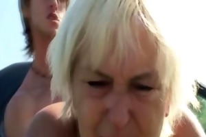 sexually excited granny receives cummed on
