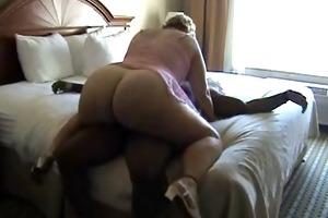 big beautiful woman older rides a knob on the sofa